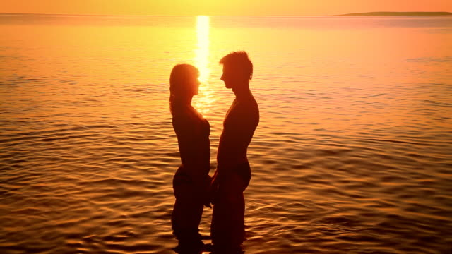 HD: Silhouette Of A Couple Kissing At Sunset video