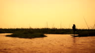Silhouette of a fisherman, Myanmar - tracking shot. video