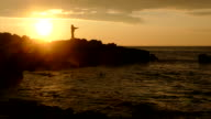 Silhouette of a fisherman with a fishing rod video