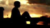 HD: Silhouette of a Girl at sunset video