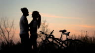 Silhouette of a loving couple at sunset. video