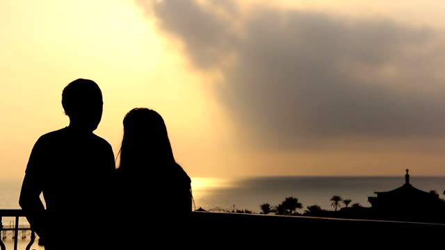 Silhouette Of A Loving Couple Dancing and Hugging Near the Sea at Sunset video