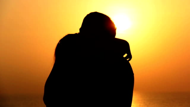 Silhouette Of A Loving Couple, Kiss Of The Sea At Sunset video