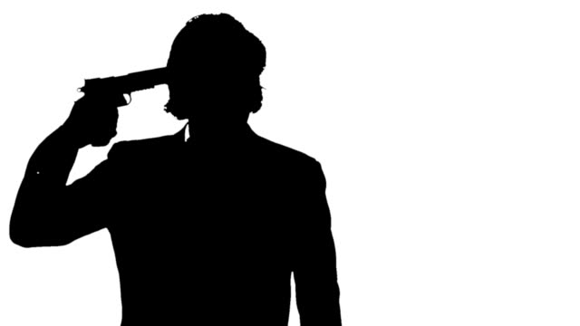 Silhouette of a man commiting suicide. video