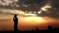 Silhouette of a Man Talking on Mobile Phone video