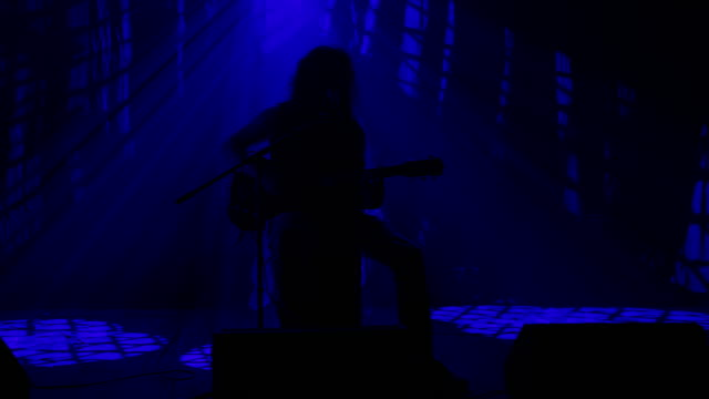 LS Silhouette of a rocker playing guitar on the stage video