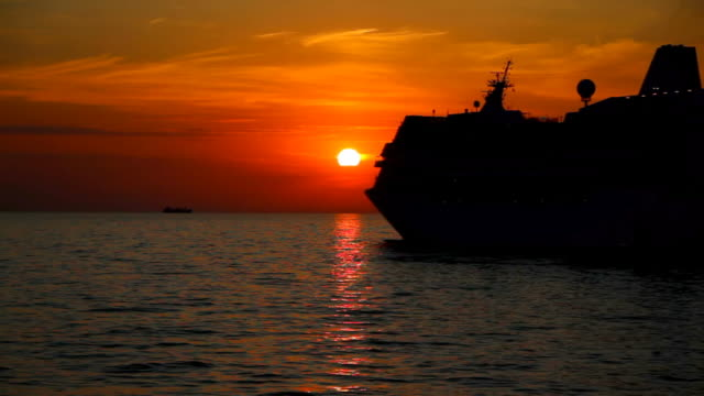 silhouette of a ship at sunset video