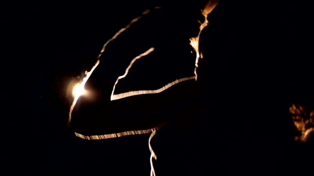 Silhouette of a strong woman boxing in the dark. Slow motion. video