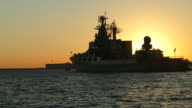 silhouette of a warship and the sun at sunset video
