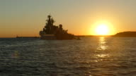 silhouette of a warship at sunset background video