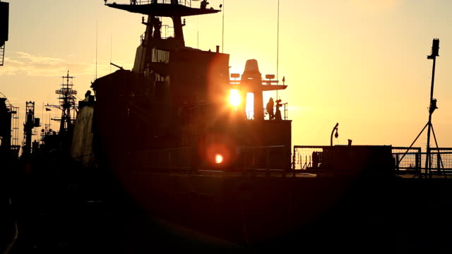 silhouette of a warship at sunset video