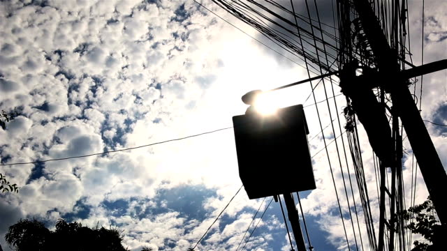 Silhouette of an electrician to repair street lighting video