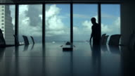 Silhouette Of Businessman On Mobile Phone In Boardroom video