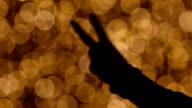 silhouette of counting fingers from 1 - 5  on shiny background video