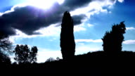 silhouette of countryside landscape with clouds and blue sky video
