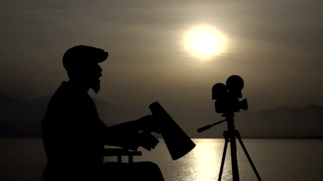 Silhouette Of Director Yelling Trough A Megaphone In Sunset video