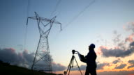 Silhouette of engineers workers at electricity station video