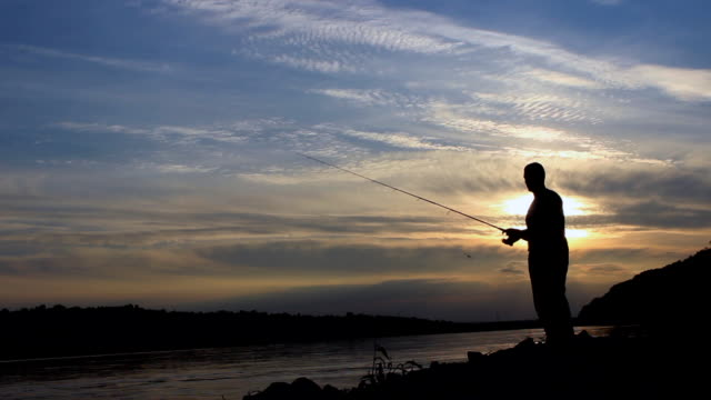 Silhouette of Fisherman on sunset, Fisherman Casting video