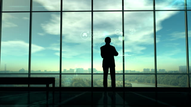 Silhouette of man and corporate infographics video