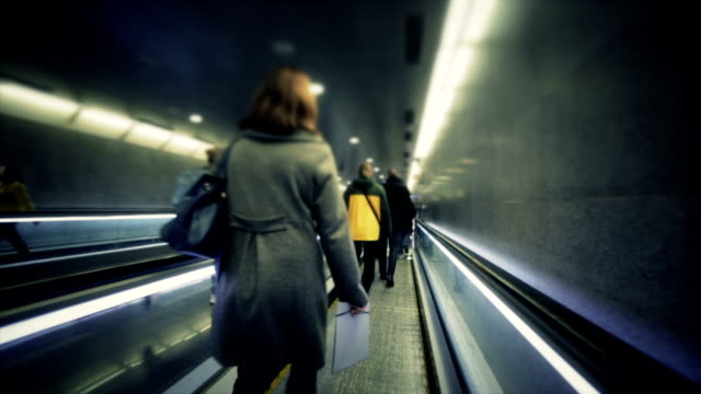 Silhouette of man on flat escalator video