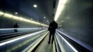Silhouette of man on moving sidewalk video