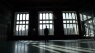 Silhouette Of Man Over Big Windows video