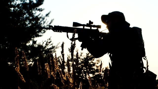 Silhouette of man with sniper rifle. Airsoft game video