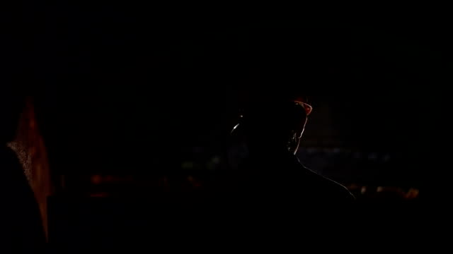 Silhouette of miner descends into a mine shaft video