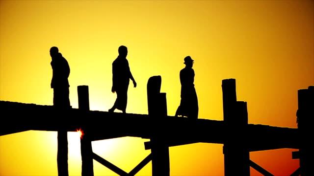 Silhouette of people walking on U-Bein Bridge in Mandalay Myanmar video