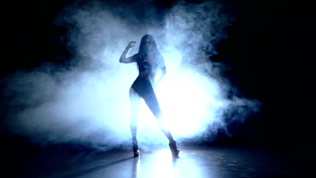silhouette of pretty stripper. Slow motion. smoke video