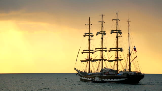silhouette of the ancient sailing ship at sunset video