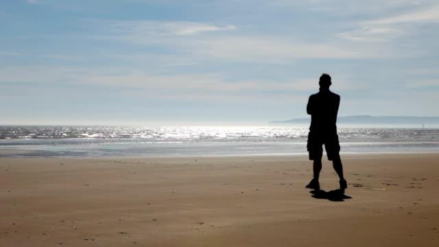 Silhouette on beach video