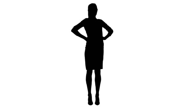 Silhouette Pretty businesswoman standing with hands on hips smiling at the camera video