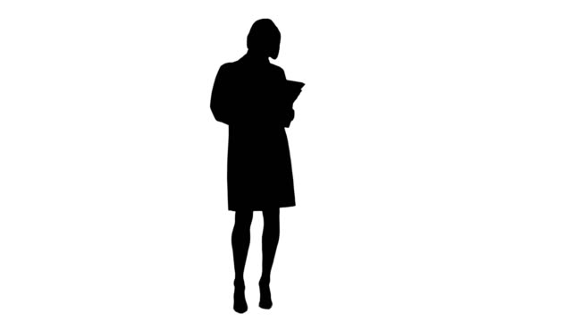 Silhouette Pretty female doctor with stethoscope using digital tablet video