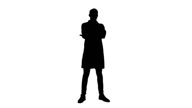 Silhouette Serious medical worker standing and folding his arms on his chest video