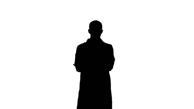 Silhouette Serious medical worker standing with his arms across his chest video