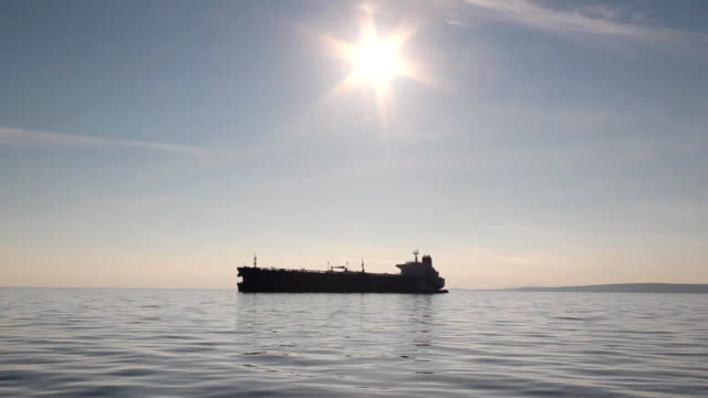 silhouette tanker at sunset video