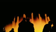 silhouette unrecognizable people in the singing fountain. The fountain is lit beautifully. Barcelona: Spain - a popular tourist destination video