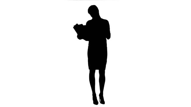 Silhouette Young businesswoman reading documents while drinking coffee video