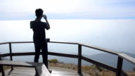 Silhouette : young man take a panorama photo video