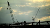 Silhouetted people Millennium Bridge London video