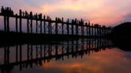 Silhouetted people on U Bein Bridge video