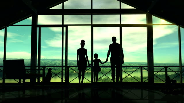 Silhouettes of a happy family on the veranda video