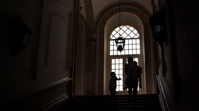 Silhouettes of family walking upstairs video