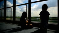 Silhouettes of girls playing in the Airport video