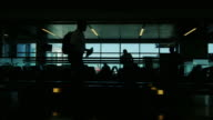 Silhouettes of passengers at the airport. A hurry on a plane or sitting in anticipation of landing video