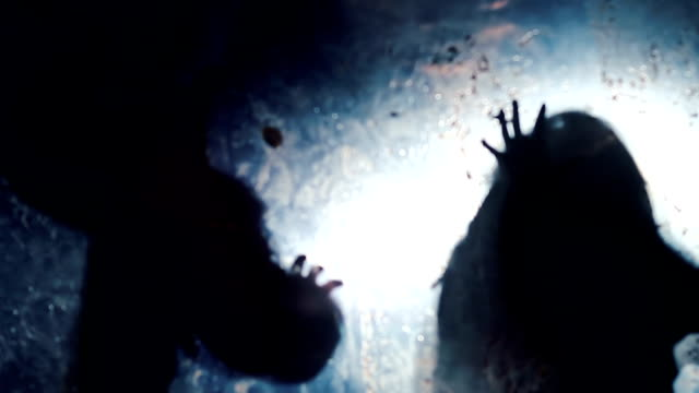 Silhouettes of scary beasts stretching hands towards victim, scary nightmare video