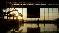 Silhouettes of travelers at the airport video