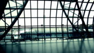 silhouettes of travellers in airport video