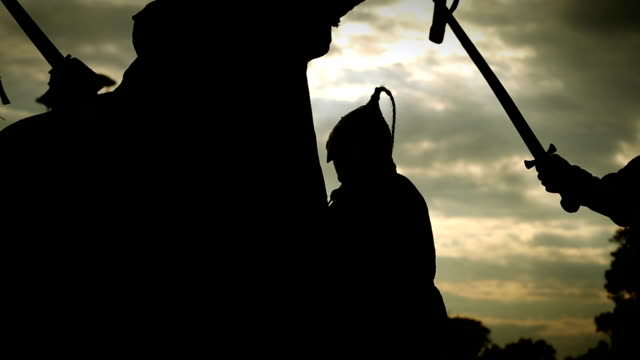 Silhouettes of warriors with swords,axes,shields with lighting sparks video
